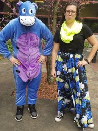 Man in an Eyore costume with woman.